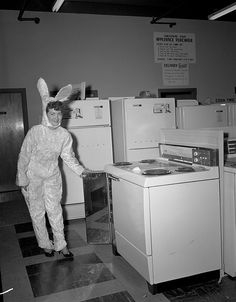 Lowes of Richmond, woman in bunny suit showing a stove - 1959 by The Library of Virginia, via Flickr