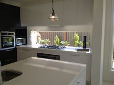 Window splashback - cupboards overhead
