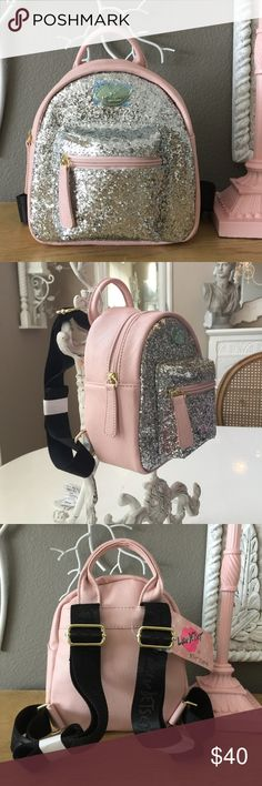 """New Betsey Blush Silver Glitz Backpack Adorable Girls Blush and silver glitz mini backpack with outside 5.5"""" x 5.5"""" pocket. Fully adjustable back straps & inside black/white stripe fabric interior with pink Betsey logo. NWT Betsey Johnson Accessories Bags"""