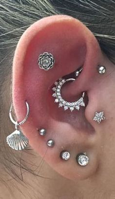 cute multiple ear piercing ideas for women flower cartilage tragus daith earring. - A Touch of Cuteness - Ear Piercing Piercings Ideas, Cool Ear Piercings, Multiple Ear Piercings, Daith Earrings, Black Stud Earrings, Cuff Earrings, Earring Studs, Ear Jewelry, Body Jewelry