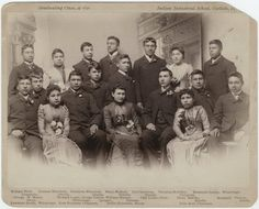 Carlisle Indian Industrial School Graduation Class in Carlisle, Pennsylvania, including George Vailier (Quapaw) sitting in the 2nd row, 3rd from the left - 1890