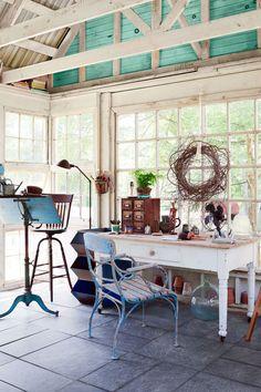 Inside this backyard retreat/shee shed, you'll an artist's studio that's totally inspiring.