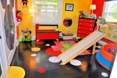 MICKEY MOUSE, Our 2 1/2 year old is a Mickey Mouse fanatic.  We Painted bold colors and made a light yellow stencil on the bright yellow wall.  We repainted all of his furniture using Mickey Mouse as our theme.  The floor is painted black with yellow, red , and white circles.  We tried to keep everything at his level and really used alot of round objects and accents., Boys Rooms Design