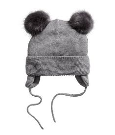 81616a5a4c0 Gray pompoms. Knit hat in a soft cotton blend with faux fur pompoms at
