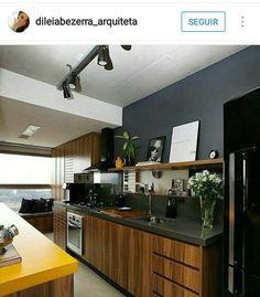 Cozinha com bancada grafite.