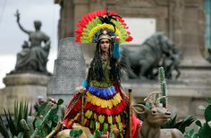 A performer representing America rides on a float during a parade as Mexico marks its 200th anniversary in Mexico City on September 15, 2010. (REUTERS/Felipe Courzo) #