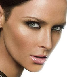 Use Bronzer on cheekbones as you would with blush then some on forehead and little on nose= contour your face