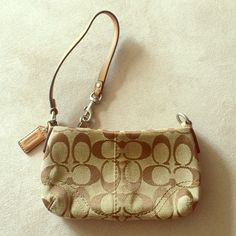 NWOT Coach Clutch/wristlet Brown new coach wristlet/clutch brown in perfect condition. Zips closed and can move clasp to attach to zipper or other side depending on style Coach Bags Clutches & Wristlets
