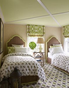 """The ceiling is painted Wales Green by Benjamin Moore. Alhambra dhurrie in grass from Vanderhurd Studio. Headboards and bedskirts, Lulu DK's Wellington; Roman shades, Island Ikat by China Seas; Indian cotton duvet covers, Muriel Brandolini White No. 5 from Holland & Sherry."""