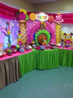 Colorful Minion Candyland girl birthday party dessert table and decorations! See more party planning ideas at CatchMyParty.com!