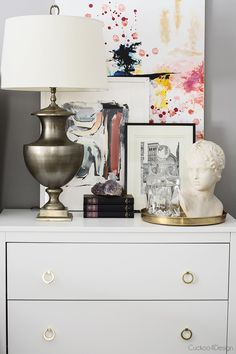 Layering Different Styles of Artwork - nightstand vignette - nightstand decorating ideas - Cuckoo4Design