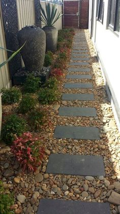 We all love a garden path, whether winding or straight. Neat as a pin or overgrown with plants, backyard garden paths lead our eye through a garden, and add charm and focus as well. However, building a walkway adds so… Continue Reading → Amazing Gardens, Beautiful Gardens, Side Yard Landscaping, Landscaping Ideas, Landscaping Borders, Natural Landscaping, Stone Garden Paths, Design Jardin, Backyard Garden Design