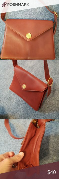 """Vintage leather crossbody Beautiful tan brown leather shoulder or croosbody bag. Strap can even be removed to use as a clutch. Exterior back pocket, interior zip pocket with red leather tassel tie, red lined signature material, gold hardware. Light distress on bottom edges. Measurements: 9.5"""" across top, 7.5"""" high, 10.25"""" across the bottom,  depth up to 3.5"""", strap drop 19.5"""" but adjustable. Excellent condition. Fred Hayman Beverly Hills Bags Crossbody Bags"""