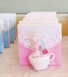 """Girly Tea Party Birthday: Favor boxes with mini """"cupcake liner"""" tea cups filled with cotton candy, for more tea party inspiration viisit Hostess With The Mostess @ http://blog.hwtm.com"""