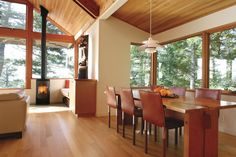 The view of the outdoors continues with corner windows that wrap around the dining area.