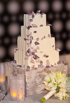 Brides.com: Fall Wedding Cakes. Inspired by the couple's wedding invitation, which featured branches and leaves in metallic and mauve hues, this cake features modern square tiers embellished with metallic gumpaste leaves for a rustic-glam look.  Cake design by Cakework