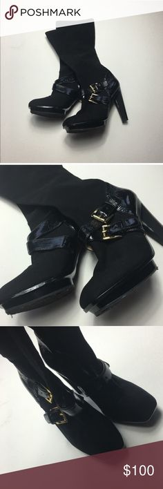 Sexy Michael kors boots Like new Michael kors boots. Size 7. Worn once. Black and gold. Stretchy material for a flexible fit. Approx 4.5 inch heal. I welcome all offers using the offer button and discount bundles but unfortunately decline trades MICHAEL Michael Kors Shoes Heeled Boots