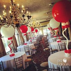 This was an incredible first birthday party!  Red and white balloon centerpieces. The fun circus theme was a blast to work with!  Balloons by Tommy | #balloonsbytommy