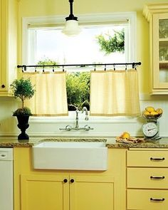 Sunny Yellow Kitchen: This charming kitchen in a 1927 Portland house - sunny yellow paint. Check out the extra-deep drawers, the Marmoleum tiles laid on the diagonal, the farmhouse sink, and the lighting from Schoolhouse Electric. Pale Yellow Kitchens, Yellow Kitchen Walls, Yellow Cabinets, Yellow Kitchen Designs, Turquoise Cabinets, Kitchen White, Dark Cabinets, Kitchen Colors, Kitchen Layout