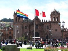 Cuzco and Peru flag in public square