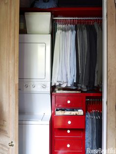 This closet houses a compact washer and dryer set.