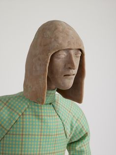 Francis Upritchard,Potato Seller, 2012, Modelling material, foil, wire, paint, fabric.
