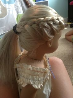 This hair style is made for a American girl doll