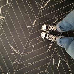 Herringbone dark entry tiles
