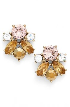 These clustered jewels form vintage-inspired stud earrings that will lend sparkle and shimmer to any outfit.
