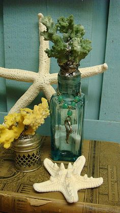 The Corals Apothecary Bottle With Green Coral Silver Leaf and Vintage Key. $32.00, via Etsy.