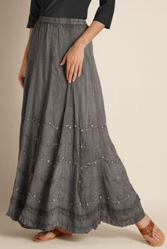 Detailed hand sewn beading, embroidry and tonal soutache make this skirt...