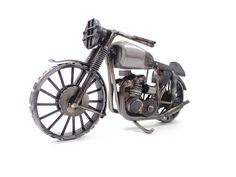 Nuts and Bolts Triumph motorcycle sculpture by Brown Dog Welding, via Flickr
