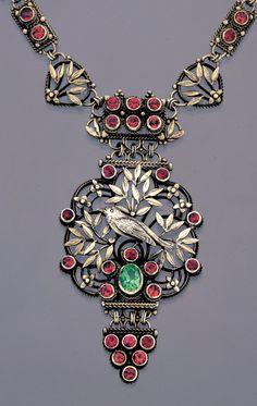 Bernard Cuzner.  Arts and Crafts bird necklace. Silver, garnet and peridot. British, c. 1905. Sold by Tadema Gallery.