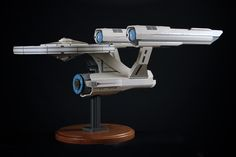 It's one thing to build a model of the U.S.S. Enterprise from Star Trek with LEGO bricks. It's another to build it so that none of those signature LEGO studs show. It took builder extrodinaire Chris Melby eight months and around 18,000 pieces to make this five foot-long masterpiece a reality.