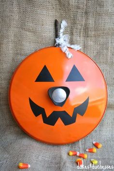 A Repurposed Jack O'Lantern Pot Lid