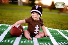 I don't have baby fever, but this is too damn cute! @Alex Grassia Football Onesie & Hat