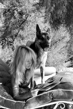 Brigitte Bardot and a German shepherd.