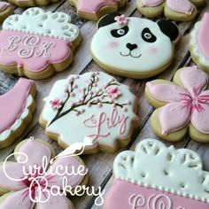 Panda and cherry blossom themed baby shower decorated sugar cookies