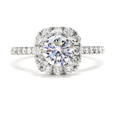 This ring features a round setting surrounded by boldly sparkling round, brilliant diamonds in the halo and band.