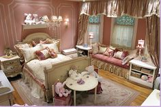 Love this little girls room. This Candice Olson room is more traditional.   Hand drawn molding on the dusty pink walls.   Over the top drapery treatments.