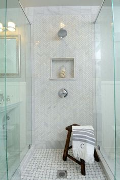Gorgeous master bathroom boasts a corner walk-in shower clad in white subway tiles accented with dark grout fitted with a Arabescato Carrera Marble herringbone tile shower floor from Home Depot. Laundry In Bathroom, Bathroom Renos, Small Bathroom, Master Bathroom, Bathroom Ideas, Family Bathroom, Design Bathroom, Hampton Style Bathrooms, Dream Bathrooms