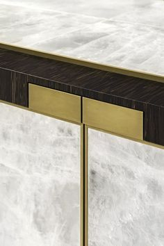 Atelier Viollet recently completed a cabinet in gypsum, palmwood & guilt bronze, designed by Jean-Paul Viollet.