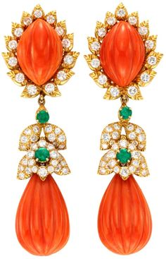 Gorgeous, luxurious drop earrings.  Carved coral with diamonds and emeralds in gold setting.  Love!