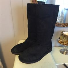 Black UGG boots size 9 tall Pair of black UGG brand boots. They are a size 9. They are the tall kind that go to your knee. They are still in really good to great condition, just have a tiny bit of fading at the base of the boot. UGG Shoes Winter & Rain Boots