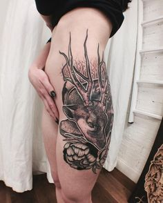 Tattoo on the thigh of the girl - deer