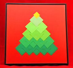 Squares of paper make this simple yet intriging Ombre Squares Christmas Tree.