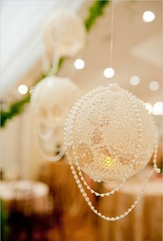 Perfect for a vintage wedding - These were made by overlapping lace doilies onto balloons; would also work for Victorian-type Christmas tree ornaments.