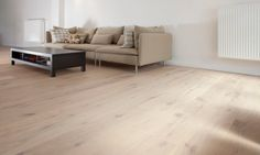 An oiled oak parquet with lots of knots, cracks and a manually distressed V-bevel. The scraped and brushed surface is oiled with Woca oil. Flooring, House Design, Furniture, House, Home, Sectional Couch, Home Deco, Coffee Table, Home Decor