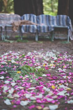 flower petals for outdoor ceremony space // photo by Evynn LeValley Photography // flowers by Big Sur Flowers // View more: http://ruffledblog.com/bohemian-big-sur-wedding/