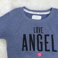 • Victoria's Secret • Love Angel Longsleeve Love angel Longsleeve by Victoria's Secret in excellent condition Victoria's Secret Tops Tees - Long Sleeve